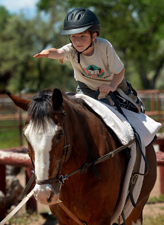 gbs050717s/LIVING -- Matthew Fehr, 9, of Albuquerque practices vaulting moves on a walking Kirby Jack during the  Cloud Dancers of the Southwest Therapeutic Horsemanship Program. (Greg Sorber/Albuquerque Journal)