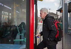 © Licensed to London News Pictures. 16/03/2016. London, UK.  Labour Shadow Chancellor John McDonnell boards a bus as he heads for Parliament on Budget day. Later Chancellor George Osborne will deliver his eighth budget to MPs.  Photo credit: Peter Macdiarmid/LNP