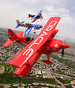 Stunt planes sponsored by the Air Force Reserve, the Air National Guard and Oracle, form up tight during a photo shoot to promote an upcoming air show at Hill Air Force Base in Utah. 6/8/07 Photo by Colin Braley