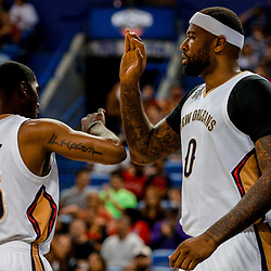 Mar 31, 2017; New Orleans, LA, USA; New Orleans Pelicans forward DeMarcus Cousins (0) celebrates after a basket and foul with guard E'Twaun Moore (55) during the first quarter of a game at the Smoothie King Center. Mandatory Credit: Derick E. Hingle-USA TODAY Sports