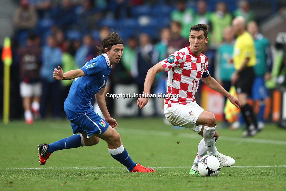 Jonathan Moscrop - LaPresse<br /> 14 06 2012 Poznan ( Polonia )<br /> Sport Calcio<br /> Europei 2012 Polonia e Ukraina - Italia vs. Croazia - Stadio Municipale di Poznan<br /> Nella foto: Riccardo Montolivo e Darijo Srna<br /> <br /> Jonathan Moscrop - LaPresse<br /> 14 06 2012 Poznan ( Polonia )<br /> Sport Soccer<br /> Euro 2012 Poland and Ukraine - Italy versus Croatia - Municipal Stadium Poznan<br /> In the photo: Riccardo Montolivo and Darijo Srna