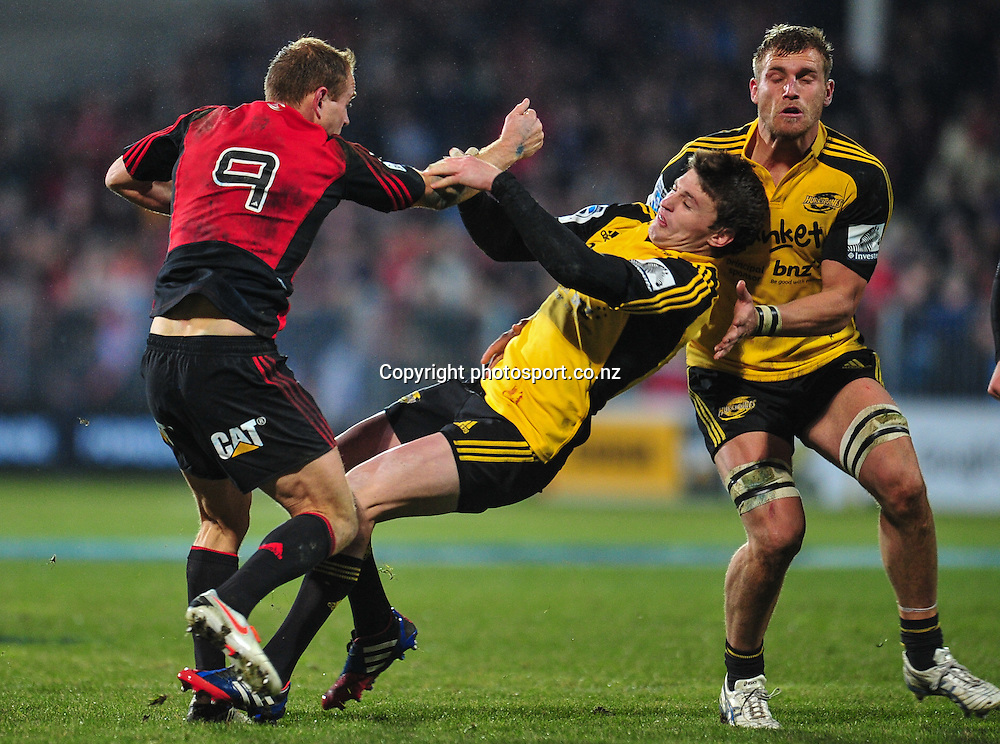 Andy Ellis of the Crusaders bumps off Beauden Barrett of the Hurricanes in the Super 15 game, Crusaders v Hurricanes, at AMI Stadium, Christchurch, New Zealand, on the 12 July 2013. Photo:John Davidson/photosport.co.nz