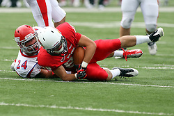 01 September 2012:  Kyle Sebetic tackles a Redbird ball carrier during an NCAA football game between the Dayton Flyers and the Illinois State Redbirds at Hancock Stadium in Normal IL