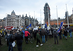 © Licensed to London News Pictures. 29/03/2018. London, UK. Crowds gather for a demonstration held by Fair Vote, outside the Houses of Parliament in London, calling for a fair vote on the EU referendum. Whistleblowers Shahmir Sanni and Christopher Wylie both spoke at the event attended by a small number of people.. Photo credit: Ben Cawthra/LNP