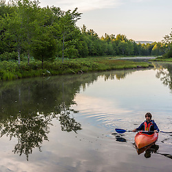 A kayaker on Northeast Creek on Mount Desert Island. Bar Harbor, Maine. Near Acadia National Park.
