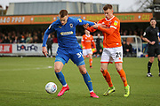 AFC Wimbledon striker Joe Pigott (39) battles for possession with Blackpool defender Calum MacDonald (29) during the EFL Sky Bet League 1 match between AFC Wimbledon and Blackpool at the Cherry Red Records Stadium, Kingston, England on 22 February 2020.