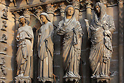Angel Gabriel, Virgin Mary, her cousin Elysabeth and king David (or Zacharie, Elysabeth's husband), annunciation group, right jamb statues of the central portal of the western facade of Notre-Dame de Reims (Our Lady of Rheims), pictured on February 15, 2009, 13th - 15th century, Roman Catholic Cathedral where the kings of France were crowned, Reims, Champagne-Ardenne, France.
