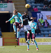 1st April 2018, Dens Park, Dundee, Scotland; Scottish Premier League football, Dundee versus Heart of Midlothian; Lewis Moore of Hearts and Roarie Deacon of Dundee compete in the air as Kyle Lafferty of Hearts watches