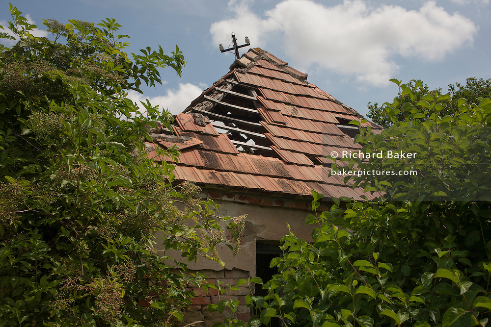 Collapsing roof of abandoned house belonging to poor, rural housing near the town of Bakonyszentlaszlo, Gyor-Moson-Sopron, Hungary