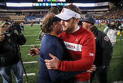 Nov 23, 2018; Morgantown, WV, USA; Oklahoma Sooners head coach Lincoln Riley talks with West Virginia Mountaineers head coach Dana Holgorsen after the game at Mountaineer Field at Milan Puskar Stadium. Mandatory Credit: Ben Queen-USA TODAY Sports