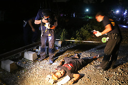 September 30, 2016 - Philippines - Members of S.O.C.O. (Scene of the Crime Operatives) process the crime scene and the remain of suspect Regie Sarmiento, 26 yrs. Old after was pin down by the members of Philippine National Police during the drugs operation in Brgy. 36, Maypajo, Caloocan City on September 30, 2016. The total suspect are 6 persons, (3 died during the operation and 3 was arrested). The operation is part of the intense campaign by the government versus illegal drugs. (Credit Image: © Gregorio B. Dantes Jr/Pacific Press via ZUMA Wire)