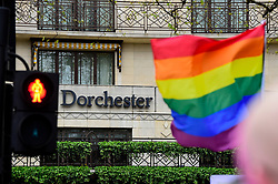 © Licensed to London News Pictures. 06/04/2019. LONDON, UK.  A rainbow flag held by a member of the LGBT community during a protest outside the Brunei-owned Dorchester Hotel in reaction to reports that the Sultan of Brunei decreed that adultery and gay sex is punishable by death by stoning in the Islamic sultanate.  Several large clients of the Dorchester Hotel have already ceased bookings in response to the decree.  Photo credit: Stephen Chung/LNP