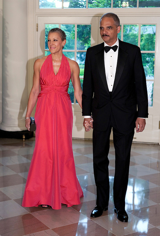 US Attorney General Eric Holder and Dr. Sharon Malone arrive for the State Dinner hosted by US President Barack Obama and first lady Michelle Obama for the President of Mexico Felipe Calderon and his wife Margarita Zavala at the White House in Washington on May 19, 2010.       REUTERS/Joshua Roberts    (UNITED STATES)