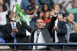 Celtic manager Brendan Rodgers lifts the trophy after winning the William Hill Scottish Cup Final at Hampden Park, Glasgow.
