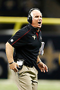 NEW ORLEANS, LA - NOVEMBER 11:  Head Coach Mike Smith of the Atlanta Falcons yells at a official during a game against the New Orleans Saints at Mercedes-Benz Superdome on November 11, 2012 in New Orleans, Louisiana.  The Saints defeated the Falcons 31-27.  (Photo by Wesley Hitt/Getty Images) *** Local Caption *** Mike Smith