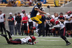 BERKELEY, CA - SEPTEMBER 12:  Running back Daniel Lasco #2 of the California Golden Bears jumps past defensive back Na'im McGee #21 of the San Diego State Aztecs into defensive back Damontae Kazee #23 during the first quarter at California Memorial Stadium on September 12, 2015 in Berkeley, California. The California Golden Bears defeated the San Diego State Aztecs 35-7. (Photo by Jason O. Watson/Getty Images) *** Local Caption *** Daniel Lasco; Na'im McGee; Damontae Kazee