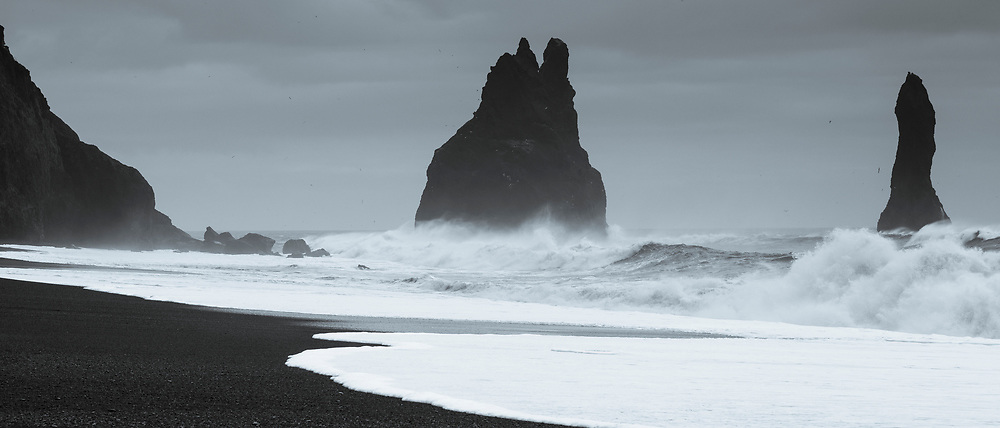Reynisdrangar basalt sea stacks (troll rocks) and black volcanic sand beach Reynisfjara near Vík i Myrdal, South Iceland