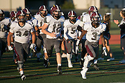 Greece Arcadia players take the field before a game at Eastridge High School on Friday, September 2, 2016.