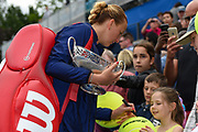 Petra Kvitova of the Czech Republic with the trophy after winning her  match (4-6) (6-3) (6-2) signing autographs for her fans after the Final of the Aegon Classic Birmingham at Edgbaston Priory Club, Edgbaston, United Kingdom on 25 June 2017. Photo by Martin Cole.