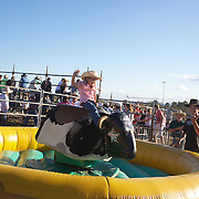A young girl enjoys a ride on the mechanical bull away from the main arena during the Branxton Rodeo at Branxton, Hunter Valley,  New South Wales, Australia, on Saturday 17th October 2009.  Photo Tim Clayton.