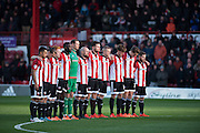 The Brentford team during a minute's silence in remembrance of the victims of the Paris attacks before the Sky Bet Championship match between Brentford and Nottingham Forest at Griffin Park, London, England on 21 November 2015. Photo by David Charbit.