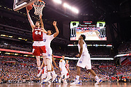 06 APR 2015:  Forward Frank Kaminsky (44) of the University of Wisconsin shoots over Center Jahlil Okafor (15) of Duke University during the championship game at the 2015 NCAA Men's DI Basketball Final Four in Indianapolis, IN. Duke defeated Wisconsin 68-63 to win the national title. Brett Wilhelm/NCAA Photos