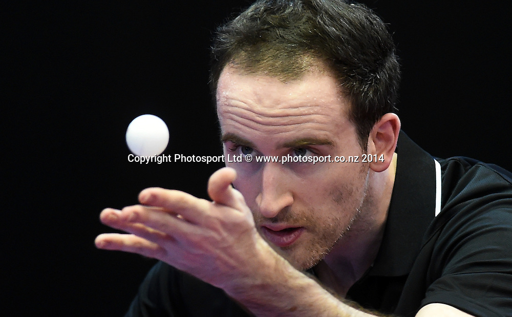 New Zealand's John Cordue training before the start of the Table Tennis competition at the Glasgow Commonwealth Games 2014. Scotland. Wednesday 23 July 2014.Photo:Andrew Cornaga/www.photosport.co.nz