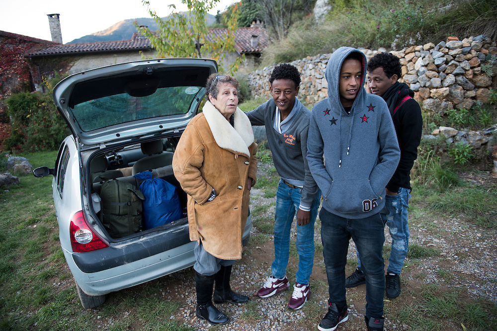 November 8, 2016 - Breil-sur-Roya, France: Fran&ccedil;oise Cotta (66) will transport three migrants to Paris - FiIlimon, 17 y, Angossom and Samuel 16 y, all three are Eritreans. Cotta is a lawyer and a member of a network that helps migrants who walked into the valley from Ventimiglia, Italy, with shelter, food and transportation.<br /> <br /> 8 novembre 2016 - Breil-sur-Roya, France: Fran&ccedil;oise Cotta (66 ans) transportera trois migrants &agrave; Paris - FiIlimon, 17 ans, Angossom et Samuel, 16 ans, tous trois &eacute;rythr&eacute;ens. Cotta est avocate et membre d'un r&eacute;seau qui aide les migrants qui sont entr&eacute;s dans la vall&eacute;e depuis Ventimiglia, en Italie, avec un h&eacute;bergement, de la nourriture et des transports.