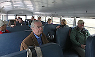 City Council member Scott Olson (left) sits on the bus as members of the Northwest Recreation Center Task Force take a tour of the five possible sites for a new recreation center in Cedar Rapids on Thursday morning, February 23, 2012. (Stephen Mally/Freelance)