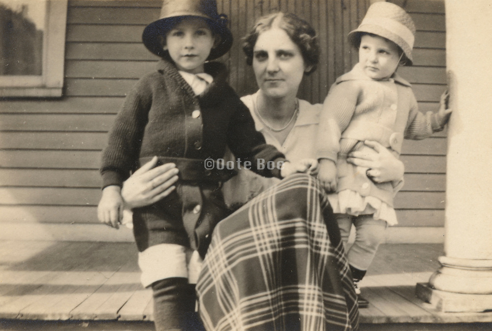 a mother posing with her two children.