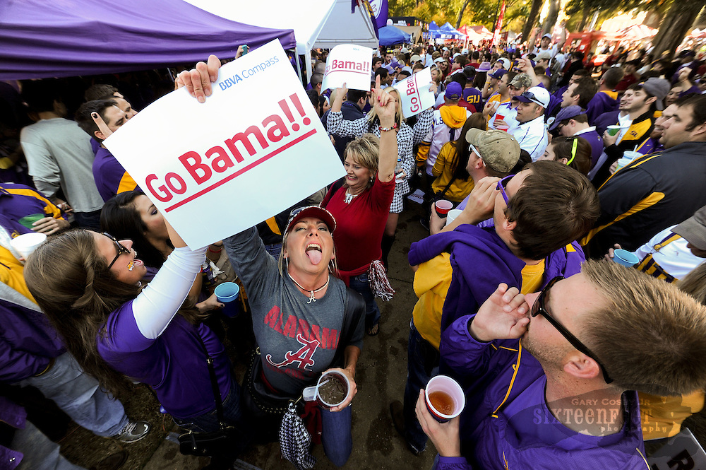 Daily Photo by Gary Cosby Jr.    ....Fans swarm Tuscaloosa for the biggest regular season matchup in years as #1 LSU plays #2 Alabama for a game that could well determine the BCS Champion.  Alabama fans walk through a gauntlet of LSU fans on the Quad near the Denny Chimes as fans have fun taunting each other before the game November 5, 2011...................................