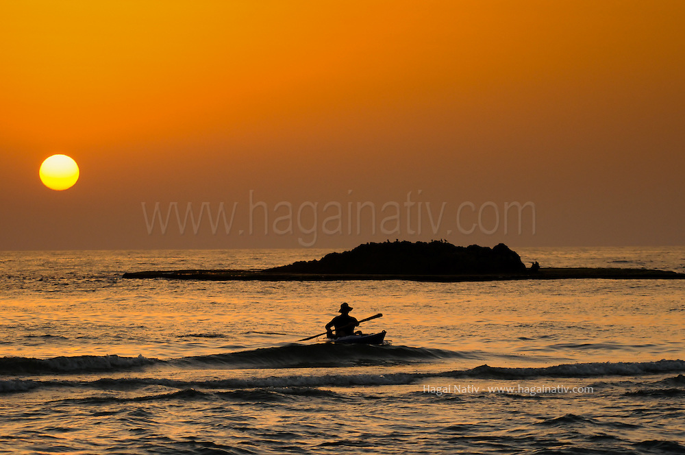 A kayak rower returning to the shore, at Maagan michael