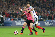 Scotland Midfielder James Forrest is tackled by England Defender Kyle Walker during the FIFA World Cup Qualifier group stage match between England and Scotland at Wembley Stadium, London, England on 11 November 2016. Photo by Phil Duncan.