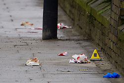 © Licensed to London News Pictures. 12/12/2016. London, UK. Blood covered materials at the scene where six people have been rushed to hospital after a Ferrari sports car ploughed in to a group of pedestrians in Battersea, South London. Photo credit: Ben Cawthra/LNP