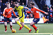 Flynn Downes, Carl Winchester and Andrew Shinnie during the EFL Sky Bet League 2 match between Luton Town and Cheltenham Town at Kenilworth Road, Luton, England on 24 February 2018. Picture by Antony Thompson.