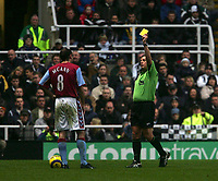 Photo: Andrew Unwin.<br />Newcastle Utd v Aston Villa. The Barclays Premiership.<br />03/12/2005.<br />Aston Villa's Gavin McCann (L) is shown the yellow card by the referee, Alan Wiley (R).