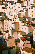 SPAIN, ANDALUSIA CASARES; a picturesque mountain village or 'pueblo blanco' near Estepona on the Costa del Sol; traditional homes and roofs