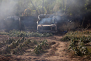 A car stands calcined in a vegetables garden after a forest fire reached a house in San Agustin de Guadalix on August 11, 2012, near Madrid, Spain. During a heat wave dozens of forest fires have appeared in Spain, three of them at National Parks, like Teide, Doñana or Cabañeros, and also thousands of people had to be evacuated at La Gomera and Tenerife, in the Canary Islands.