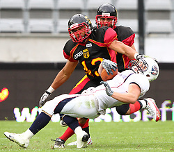 10.07.2011, Tivoli Stadion, Innsbruck, AUT, American Football WM 2011, Group A, Germany (GER) vs United States of America (USA), im Bild tackle from Steve Nzeocha (Germany, #43, LB) against Nate Kmic (USA, #1, RB)  // during the American Football World Championship 2011 Group A game, Germany vs USA, at Tivoli Stadion, Innsbruck, 2011-07-10, EXPA Pictures © 2011, PhotoCredit: EXPA/ T. Haumer
