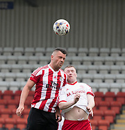 Steven Archibald heads clear - Dundee Argyle v Dykehead AFC in the Scottish Sunday Trophy semi final at Excelsior Stadium, Airdrie, Photo: David Young<br /> <br />  - &copy; David Young - www.davidyoungphoto.co.uk - email: davidyoungphoto@gmail.com