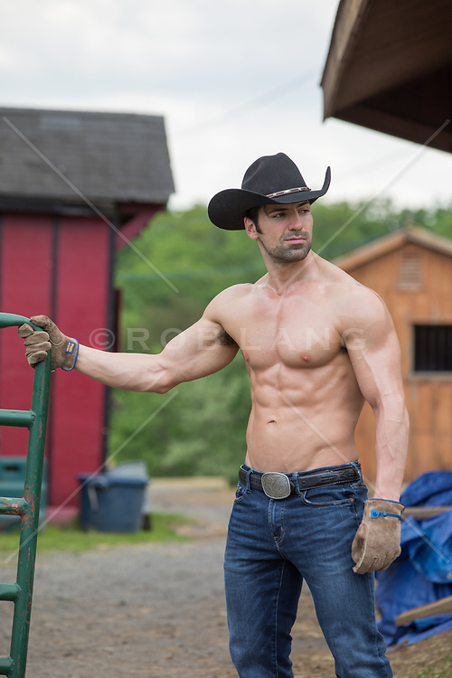 muscular shirtless cowboy on a ranch