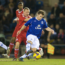 WIDNES, ENGLAND - Tuesday, February 17, 2009: Liverpool's Jay Spearing and Everton's Scott Spencer during the FA Premiership Reserves League (Northern Division) match at the Halton Stadium..(Mandatory credit: David Rawcliffe/Propaganda)