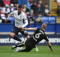Gary Madine of Bolton Wanderers (L) and Liam Cooper of Leeds United in action - Mandatory by-line: Jack Phillips/JMP - 06/08/2017 - FOOTBALL - Macron Stadium - Bolton, England - Bolton Wanderers v Leeds United - English Football League Championship