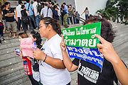 "23 JANUARY 2013 - BANGKOK, THAILAND:  Supporters of convicted magazine editor Somyot Prueksakasemsuk picket the front of Bangkok Criminal Court after Somyot's sentencing. Somyot was sentenced to 11 years imprisonment on ""Lese Majeste"" charges Wednesday. He was arrested on April 30, 2011, and charged under article 112 of Thailand's penal code, which states that ?whoever defames, insults or threatens the King, the Queen, the Heir-apparent or the Regent, shall be punished with imprisonment of three to fifteen years"" after the magazine he edited, ""Red Power"" (later changed to ""The Voice of Thaksin"") published two articles by Jit Pollachan, the pseudonym of Jakrapob Penkair, the exiled former spokesman of exiled fugitive former Prime Minister Thaksin Shinawatra. Jakrapob, now living in Cambodia, has never been charged with any crime for what he wrote.      PHOTO BY JACK KURTZ"