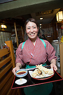 Masami Suzuki, 28 years old, is working as at the Sarashina Horii Noodle Restaurant in Tokyo, Japan.