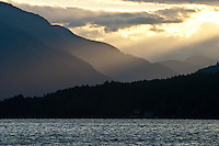 Sun breaks through clouds over Sproat Lake Vancouver Island
