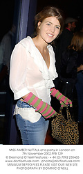 MISS AMBER NUTTALL at a party in London on 7th November 2002.	PFB 129
