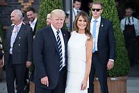 Donald Tump (L), Praesident Vereinigte Staaten von Amerika, nach dem Familienfoto der G20 Teilnehmer und ihrer Partner vor der Elbphilharmonie<br /> IMAGE: 20170707-02-034<br /> KEYWORDS: G20 Summit, Deutschland, Elphi