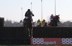 Bags Grove and Noel Fehily (left) clears the last fence before winning The 888Sport Pendil Novices' Steeple Chase Race run at Kempton Park Racecourse.