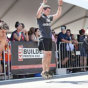 Competitors who failed to overcome an obstacle do penalty squats during the Reebok Spartan Race. Mohegan Sun, Uncasville, Connecticut, USA. 28th June 2014. Photo Tim Clayton